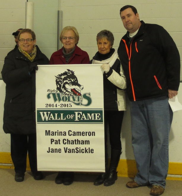 Pat Chatham, left, Jane VanSickle and Marina Cameron and inducted onto the Wolves Wall of Fame by Kevin Taylor, the President of the Wolves executive.