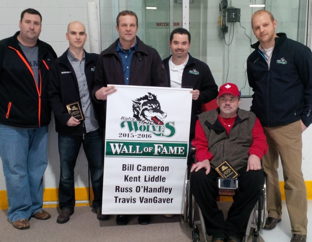 Kevin Taylor, left, President of the Ripley Wolves executive, and Mark Smith, right, Wolves head coach, honoured new Wall of Fame members Travis VanGaver, Russ O'Handley, Kent Liddle and Bill Cameron on Friday night.